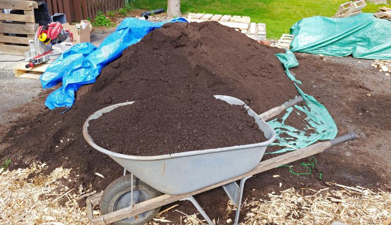 Soil pile and wheelbarrow